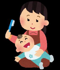 歯磨きをしてもらう赤ちゃん